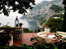 Island of Capri. A summer day on Capri island with a beautiful view of sea from a restaurant Royalty Free Stock Image