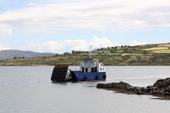 Island car ferry. A small island car ferry coming in to dock in county cork ireland Royalty Free Stock Image