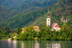 Island with Catholic Church on Bled Lake in Slovenia. Hill with Stock Images