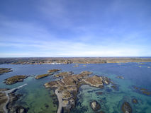 Island chain in Norway aerial view, drone view. Uttian, Norway - March 20, 2017: The Norwegian coast island. The island is flat and sparse vegetation. The stock images