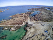 Island chain in Norway aerial view, drone view. Uttian, Norway - March 20, 2017: The Norwegian coast island. The island is flat and sparse vegetation. The stock photo