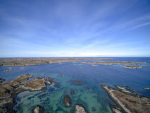 Island chain in Norway aerial view, drone view. Uttian, Norway - March 20, 2017: The Norwegian coast island. The island is flat and sparse vegetation. The stock photos