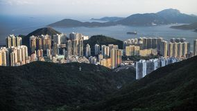 Many buildings​ in mountianous ​and seaside location in Hong​ Kong​ island. Panoramic view of many buildings​ in mountianous royalty free stock photos