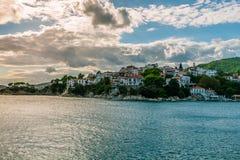 Island city at sunset. The port on the Greek island of Skiathos at sunset, September 2018 stock photo