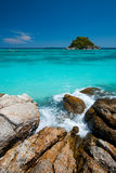 Island In Clear Aqua Ocean Stock Photo