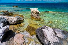 Island with clear blue water. And rocks Royalty Free Stock Photos