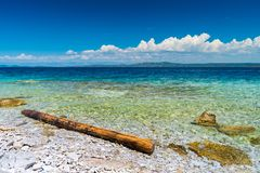 Island with clear blue water. And rocks Royalty Free Stock Image
