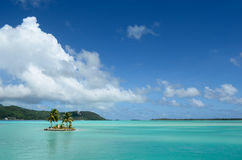 Island in the clear Bora Bora lagoon royalty free stock photos