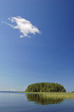 Island and cloud. Finnish lake scene in summer Stock Photography