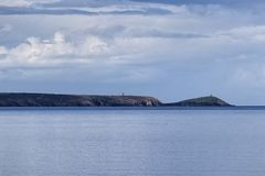 An island of the coast in an Irish bay stock photos