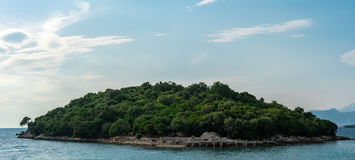 Island on coast before Khsamil. One of three beautiful islands next to Albanian city Khsamil stock image