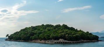 Island on coast before Khsamil. One of three beautiful islands next to Albanian city Khsamil Stock Image