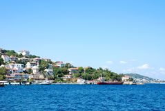 Island  coastline. Scenic view of coastline of  island with calm blue sea in Istanbul, Turkey Royalty Free Stock Photo