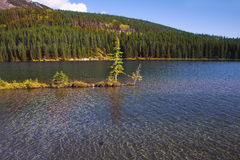 The island in cold Canadian lake Royalty Free Stock Photo