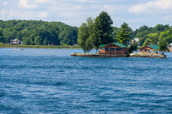 Island with a cottage Royalty Free Stock Photos