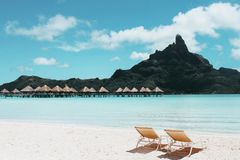 An Island with Cottages and Beach Chairs. royalty free stock photos