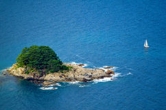 Island covered with pine trees stock photos