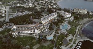 The Island of Cyprus at Dusk. Aerial view of the island of Cyprus at dusk. Flying over hotels situated at the seaside and above beautiful calm Mediterranean sea stock footage
