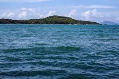 Island in the distance off the coast of Rawaii royalty free stock photo
