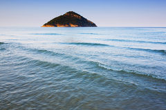 Island in distance. And sea in sunset light Royalty Free Stock Photography