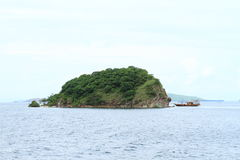 Island with divers boat Royalty Free Stock Image