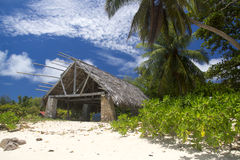 The island of dreams. Big bungalow on sandy Stock Image