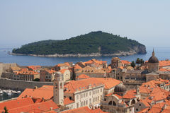 Island and Dubrovnik old town. Red tile roofs and island on a background. Dubrovnik, Croatia Stock Photo