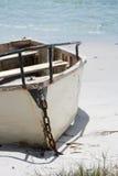 Island Escape. A dingy anchored on a sandy beach stock image