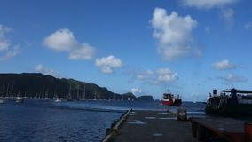 Island ferries maneuvering at a jetty in the caribbean stock video footage
