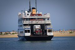 Island Ferry in Summer. Large truck on a Ferry coming in to shore Royalty Free Stock Image