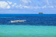 Island Fishing Boat in Turquoise Waters Stock Photography