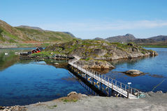Island with fishing village in fjord, Mageroya. Royalty Free Stock Photography