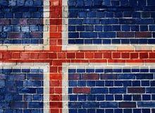 Island-Flagge auf einer Backsteinmauer Lizenzfreie Stockfotos