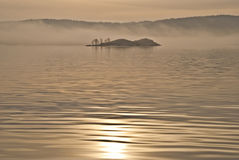 Island in the fog. (3). Small island in the fog, just outside Halden port Stock Photo