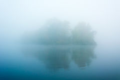 Island in the fog Royalty Free Stock Photo