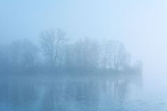 Island in the fog Stock Images