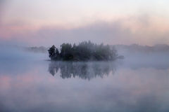 Island in fog Stock Images