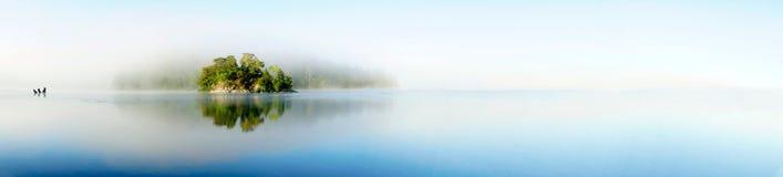 Island on foggy morning Royalty Free Stock Photos