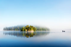 Island on foggy morning Royalty Free Stock Image