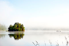 Island on foggy morning Stock Photography
