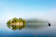 Island on foggy morning Stock Photos