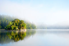 Island on foggy morning Royalty Free Stock Photography