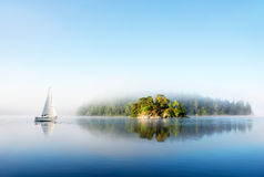 Island on foggy morning Stock Images
