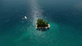 Island in the form of heart in the ocean and flying plane stock footage