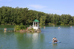Island with a gazebo on a lake Aya. Altai. Stock Photo