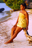 Island girl in yellow Royalty Free Stock Images