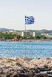 Island with a Greek flag. The resort of Faliraki. Rhodes Island Royalty Free Stock Photos