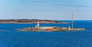 Island Harmaja in  Gulf of Finland with pilot station. Small island Harmaja Grahara in Gulf of Finland with pilot station, lighthouse and marine navigation Royalty Free Stock Images
