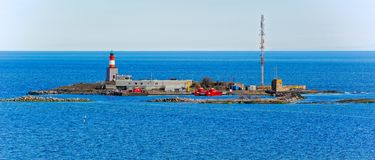 Island Harmaja in  Gulf of Finland with pilot station. Small island Harmaja Grahara in Gulf of Finland with pilot station, lighthouse and marine navigation Stock Images