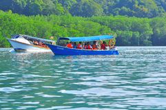Island hopping boats to beautiful tropical island Royalty Free Stock Image